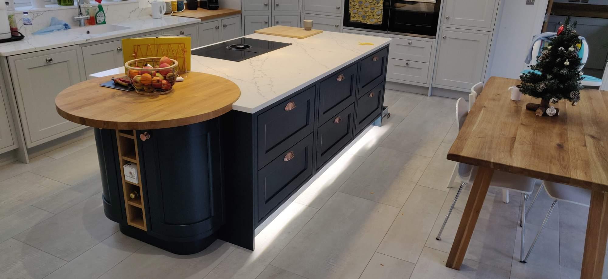 Hague Blue Kitchen Island, AEG Vented Recirculating Hob, LED plinth lights